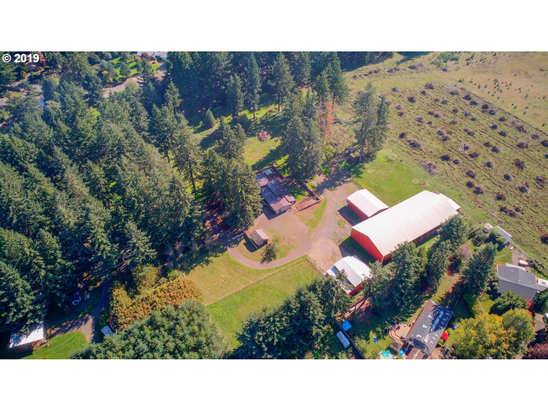 Hidden Private Equestrian Estate! Featuring a lovely country home with 3 beds, 2.5 baths,  open, vaulted, expansive rooms, & fresh interior paint. A 2006 built 60x144 indoor equestrian arena w/ viewing room, 2004 built barn w/ 11 horse stalls w/ income potential of $450/mo per stall, detached bonus building, new 40x48 outbuilding w/ RV hkp & covered storage. New $25k Metal Roof on home. Dog training?Storage facility? Canby Schools!