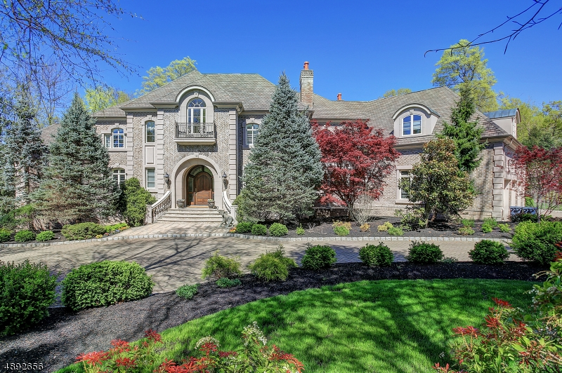This property is one of the most spectacular, residential offerings to be presented in all of coveted Warren Township. The supremely custom, 2-story, brick residence is magnificently-finished on 3 levels and beautifully positioned at the end of a cul-de-sac of distinctive homes on a glorious, 2 acre, level parcel. The home's statistics & architectural details are too numerous to be aptly described within the confines of MLS parameters. The images convey a keener perspective of this stunning home inclusive of a secret, 5-car garage, smart-home technology, brilliant trim, finishes & designer floors. The hardscaping, specimen plantings, Koi Pond, terraces & patios at the rear grounds create an outdoor environment like no other. Extraordinary, immaculate and in astonishingly  'like new' condition throughout.