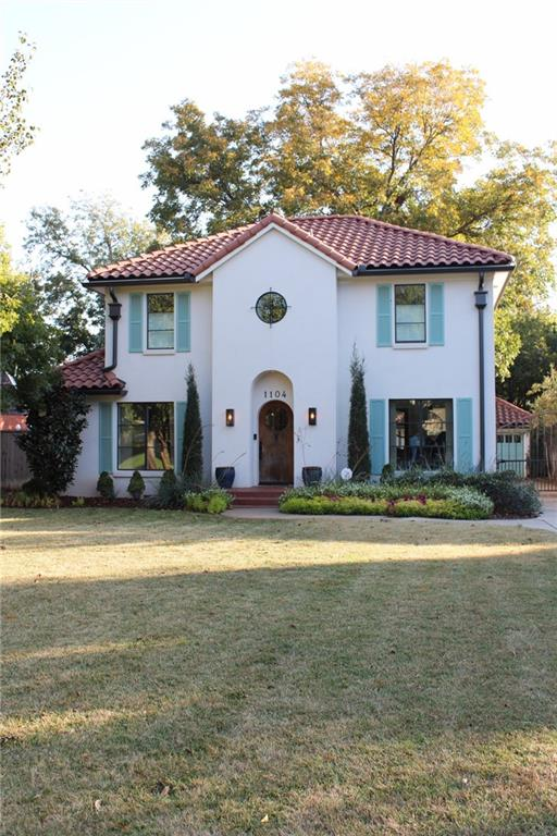Newly remodeled in 2016 and located in the heart of Downtown Nichols Hills. This house is unique in every way. The Southern California charm makes it stand out in a crowd.   Details: high ceilings on both stories, a unique concrete and clay tile roof (only 4 years old), hard-wood floors and tile throughout the house, a covered balcony overlooks the back yard and covered patio below, the kitchen counters are butchers block and the appliances are Viking. It makes cooking enjoyable. Everything from the landscaping to the surround sound speakers and canned lights make this home a MUST SEE. Tons of tall windows and natural light. Interior design by Jennifer Welch Designs as seen on Sweet Home Oklahoma, furniture can be included.   Within walking distance to Nichols Hills plaza and many other great, local, amenities!