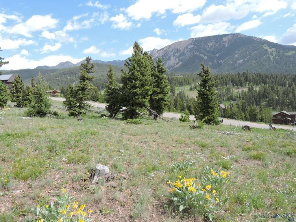 This ridge lot has views of Lone Mountain, Yellow Mountain and even looking east toward Ramshorn and the Gallatin Canyon.  As a ridge lot it is very sunny and has a great building site.
