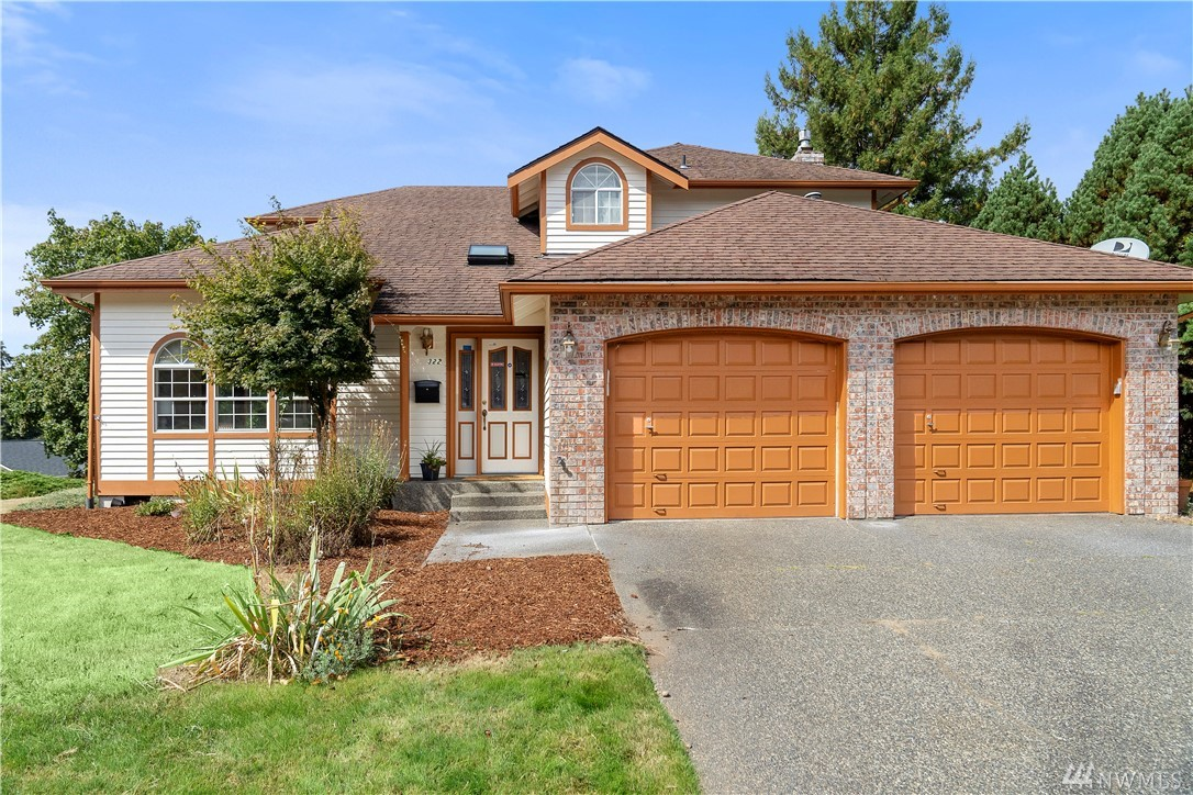 This corner-lot home was beautifully maintained by the original owners, and now it's waiting for you! Located in Steilacoom, minutes from Sunnyside Beach, JBLM & the charming downtown historic district. Versatile floor-plan w/ two living & dining spaces on the main floor, as well as a covered deck for year-round enjoyment. Sizable master suite + two more bdrms upstairs. Vaulted ceilings, skylights & abundant windows amplify the natural light. Central heating & cooling + sprinkler system.