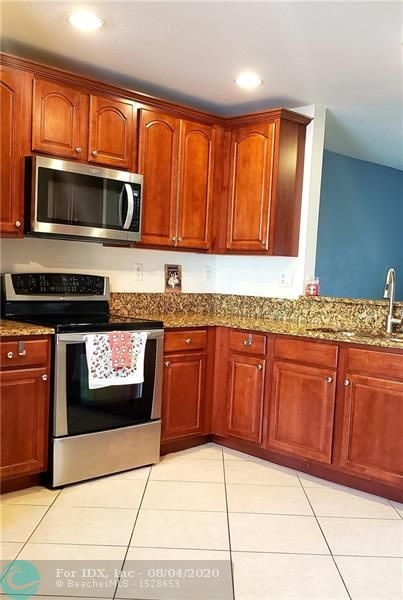 Located in the beautiful Hampton Hills community. This canal view townhome faces west to watch the sunsets on the screened in patio. Unit features 3 bedrooms and 2.5 bathrooms. Beautiful kitchen with wood cabinets and granite countertops. Second floor is finished with new wood floors and first floor is tile. Community features a clubhouse, exercise room, community pool and much more.