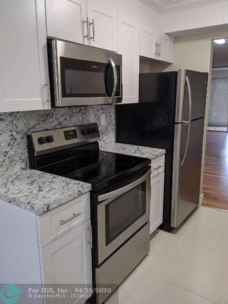 Completely remodelled new kitchen,bathrooms,floors,aircondition,screeded patio,s.s.appliances and much more...Some of the amenities: billard,schuffle board,exercise room and pool.  Per  association 20% with offer per condo rule, $35,000 annual income,  650 credit score and 55+..Your buyers will fall in love with this transformed condo...Near Hospital, Banks, Shopping and transportation.