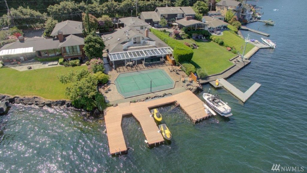 Spectacular western facing Lake Washington home w/75' of low bank frontage & exceptional privacy.  3 finger dock w/deep water moorage fits 4 boats + has boat lift & 2 Sea Doo lifts.  If you like to entertain then this home is for you w/a huge sports court, 20 person hot tub/swim spa, sauna, outdoor shower & gas firepit.  2 car attached garage + 8 additional off street parking.  Separate artist studio + shop.  3 bedrooms, 3.5 baths, bonus/exercise room, office, A/C, 4 gas fireplaces & generator.