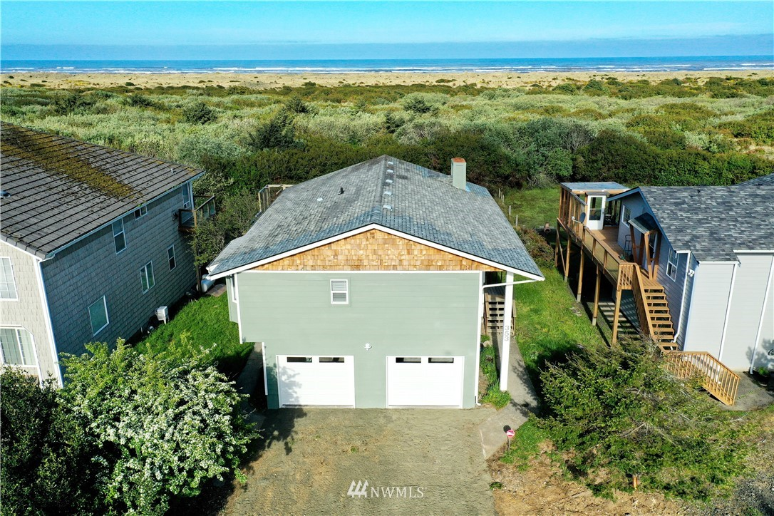This oceanfront residence with private access to the beach can be yours soon. The new kitchen has Kitchen Maid self-closing wood shaker cabinets. The lovely granite countertop is easy cleanup. The stainless steel appliances have been upgraded with the oven having a built in air fryer.  The large master bedroom has a 9' long closet and a bay window to put a comfortable chair to enjoy a good book. Downstairs is a bedroom and bath/laundry room along with a family room or office for complete privacy. The extra large two car garage is completely finished.  The flooring is Mohawk laminate throughout.  Brick fireplace, 2 separate outside patios to enjoy the Ocean views.  This home has new plumbing, sheet rock, insulation, and electrical.