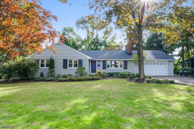 Move right in to this beautifully renovated 4 BR/3 FB ranch offering plenty of living space. Modern kitchen with granite countertops & SS appliances.  Spacious bright family room w/double sliders to patio, DR & LR w/wood burning fireplace. Master BR w/large en suite. 3 addtl BR & large hall FB. Separate laundry/mud room on main level. Hardwood floors throughout. New roof, 2 zone CA, BB heat, new water heater. Huge finished basement w/FB. Attached 2 car garage. Spacious yard. Top rated schools & convenient transportation to NYC! This home comes with a 1 year Home Warranty.