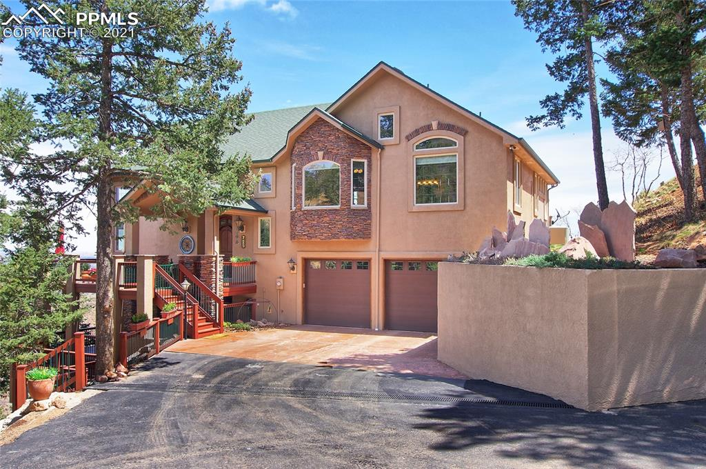 Large Decks and Cherry Arched Top Front Door Welcome You To This Beautiful Custom Palace Home In Lower Crystal Park With Stunning Views! Perfectly Located On .7 Acres, Only 5 Minutes From Manitou Springs. This Property Boasts Colorado Living At Its Finest! High Ceilings And An Abundance Of Natural Light Lead You Through This Entire 1.5 Story Home with fully finished basement! The Living Room Invites You With Ceiling-To-Floor Windows, A Stone Face Gas Fireplace, Vaulted Ceilings And Two Walk Outs! The Kitchen Is Truly The Heart Of This Home With Suede Granite Countertops, Decorative Travertine Flooring And Countertop Backsplash, Drop Lighting Over The Counter Bar, Large Walk-In Pantry, And Gas Range! You'll Find Pull Out Shelving In All Lower Cabinets! Top-Of-The-Line (GE Monogram) Stainless Steel Appliances And Custom Designed Cherry Cabinets Make This Room One You'll Never Want To Leave! Dining Room Features A Designer Chandelier And Take-Your Breath Away City And Mountain Views! All Fixtures/Faucets In The Home Are Kohler, Window Dressings Are Custom Hunter Douglas And Windows And Doors Are Pella. The Master Bedroom Offers Two Walk-In Closets, A Double Door Walk-Out To Deck And Patio, Remote Control Velux Skylight, Vaulted Ceilings And An Additional Closet! Two Vanities With Travertine Countertops And Cherry Cabinets, Large Soaking Tub And Glass Stand Alone Shower Make The 5-Piece Master Bathroom Suite A Luxurious And Warm Addition! Relax In The Upper Level Office/Bedroom, Just Steps From The Master Bedroom. Walk Down The Custom Staircase With Wrought Iron Banisters To The Family Room With Another Walk Out And Built-In Shelving Frame The Second Stone Face Gas Fireplace! Additional Bedrooms Share The Full Bathroom W/ Granite Vanity And Decorative Travertine Flooring. Wet Bar W/ Custom Cherry Cabinets. Garage Is A 3 Car Tandem W/ epoxy flooring. This Home Was Build With Custom Craftsmanship And Maintained Perfectly. Newer HVAC System, A/C, Refrigerator And Cook Top.