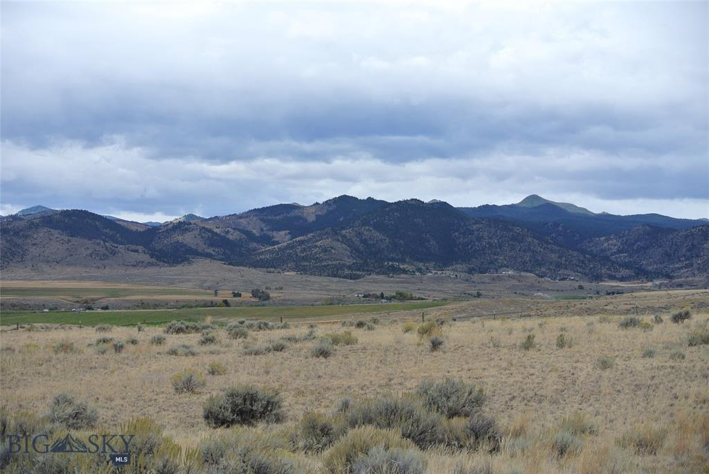 22+ acres with limited covenants. Allows modulars or manufactured home if on a permanent foundation. Natural gas and electricity to the property. Sits on high ground at north end of the Jefferson River Valley overlooking the valley from the Tobacco Root mountains to the Continental Divide. Fenced and cross fenced with smooth wire for horses and only a short ride to thousands of acres of public land. MOTIVATED SELLER SO GO SHOW!