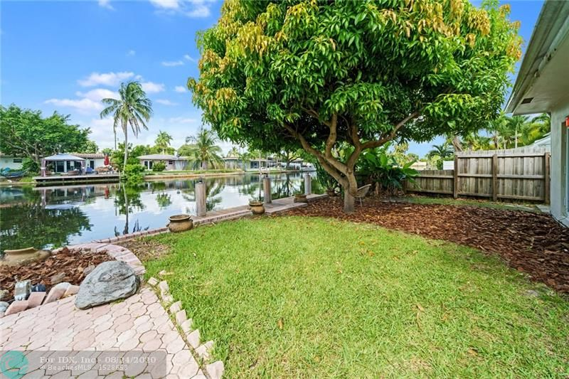 Beautiful Secluded Neighborhood Waterfront Home. Studio/Guest House can be rented for $1000/Month. 29' Eat In Kitchen w/Skylight.  13' Ceiling Custom Cabinetry. 18' Dining Room w/Skylight. Den/TV Room Custom Cabinetry. Full Laundry w/End Refrigerator. Large Master Bedroom w/ Walk-in Closet and new Bathroom. 2nd Bathroom Updated. Rebuilt Dock. New Diamond Brite in Pool. Outside Bar.