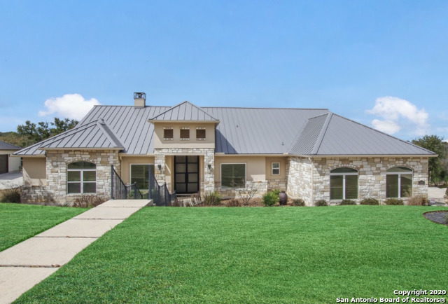 Designed to exemplify one story Texas living, this gated community home has a range of unique features incorporated into a  beautiful one-story 4 bed/4 large bath home w/ stunning modern design w/ contemporary flair & hardwood floors throughout. Thermador commercial grade built-in appliances w/ 6burner range & griddle and 4 built in ovens, a chefs dream kitchen including quartz counter tops. A Luxurious master suite w/large spa bath. Sophistication at it's BEST! Built for entertaining and relaxation!