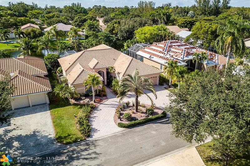 Beautiful 5 bed  bath home in Gated Community with 24 hour guarded gate! This meticulously maintained waterfront home sits on a 9750 SF Lot. 5 large bedrooms and 3 Full Bathrooms with Screened in Pool and Jacuzzi. Updated kitchen includes stainless steel appliances, granite counter tops and high end appliances. Tiles floors, crown molding and recessed lighting throughout.