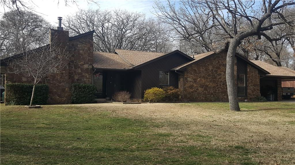 What a wonderful find in North Edmond! 1 1/2 acre with lots of trees, this spacious 3 Bed 2 Bath Classic has something for everyone. The Master bed has a Fireplace & the Master Bath features double vanities a large walk in closet & separate tub & large shower. The 2nd Bedroom is large with a walking closet & the 2nd and 3rd beds share the 2nd bath. The kitchen is magnificent with granite counters, lots of cabinetry with lighting underneath and above. The Dining room is just off the kitchen with space for a large table and hutch. The Spacious living room features a Fireplace, Vaulted ceilings, bookshelves & a wine bar.  Step out to the extended patio that is designed for entertaining with lots of space for grills and outdoor furniture. There is also a shop with power, currently hosts woodworking power tools. There's a 2 car garage and a carport. Many recent updates like tile flooring and lots of fresh paint and carpet. There's an underground electric dog fence in the backyard. Wonderful