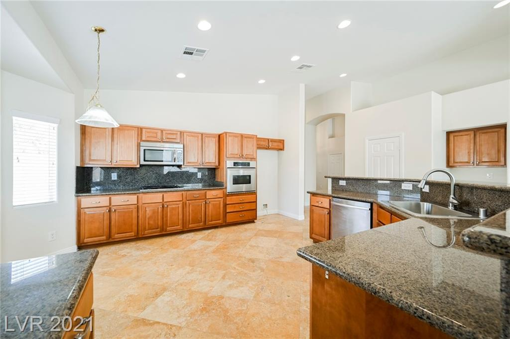 Understated 3,000 sq ft home in Mountain's Edge on a 13,000 sq ft lot in an exclusive gated community on a corner lot!!  Dual masters with large walk in closet in both! Unique floor plan that separates both masters, the LARGE backyard is just perfect for entertaining!  All conveniently located next to shopping, restaurants and freeways.  Schedule a tour today!