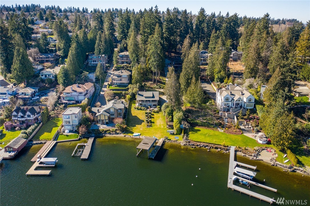 """RARE opportunity to own this QUIET NORTH END shy acre street-to-water homesite w 83 feet of no bank waterfront.  Home is livable while you plan your dream estate or potential development plans for multiple homesites with waterfront and unobstructed water views! First time to market in generations, one of VERY FEW waterfront lots that has not been subdivided!  COVERED private boat dock is grandfathered, can """"trade"""" covered for potential to extend length for deeper moorage. LAND VALUE!"""