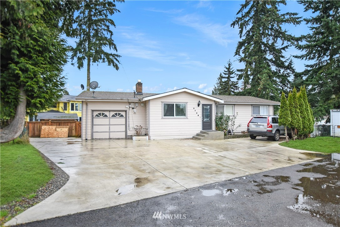 """Awesome place to call """"HOME!"""" Comes complete w/ sprawling yard, 6 bedrooms & 2 baths ~ You have space for EVERYONE, while being close to EVERYTHING! Nice sized bedrooms & unique spaces. Looking for multi-gen living or potential for rental income? Lower level has Kitchenette, 2 bedroom & bath ~ Great MIL space! Upstairs kitchen leads out to Expansive, partially covered Deck for year-round BBQ's, entertaining or watching the dogs run in the yard. Large driveway to park your cars or toys. Fenced backyard provides hours of fun and a nice place to play. Just a short walk to coffee, schools, restaurants, grocery, bus line, etc. Get to SeaTac airport and / or South Center Mall in a jiffy. Just minutes to i-5, 405, 99 for an EASY COMMUTE! Welcome!"""
