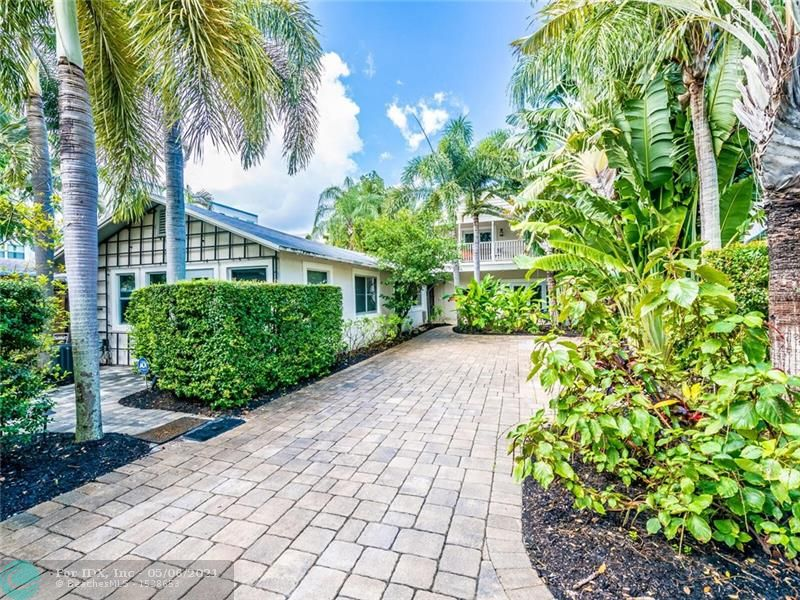 This unique private Key West inspired tropical compound in the heart of Victoria Park sets itself apart from other houses in the neighborhood. Completely renovated to perfection. The massive iron gates lead you through an amazing breezeway that connects the front cottage to the 2 story residence. Main house features formal entry, open living/dining area w/vaulted ceilings, Chef's kitchen, 1 master suite downstairs w/private patio. New wood floors & impact sliding/french doors overlooking the lushly landscaped heated pool & patio.  Master suite occupies 2nd floor & includes a huge loft & private balcony. Custom built closets.  Cottage/Guest House (900 sq ft) includes 2 big rooms, full new kitchen, W/D & separate patio. All furniture included (approx $25k). Owner wants to sell turnkey.