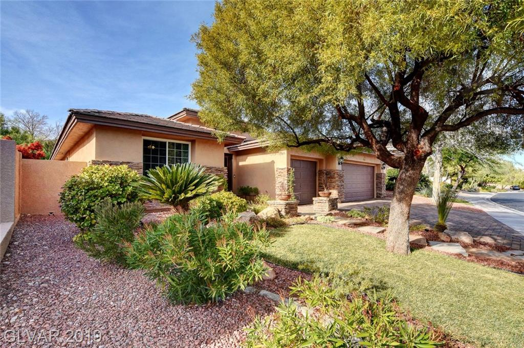 GORGEOUS in Summerlin gated neighborhood of all 1-story homes. Highly upgraded in past yr: new floors/baseboards, kit cabs & backsplash, doors, energy-efficient windows thruout, lndry rm sink/cabs, bath cab/counters! Open floor plan, great rm, DR, kit island, granite counters, built-in SS appls. MBR: hardwood floors, shower, tub, dbl sinks, custom WIC. Cov patio, pavers, lawn. Excel curb appeal, stone-accents, wrought-iron entry, driveway pavers.