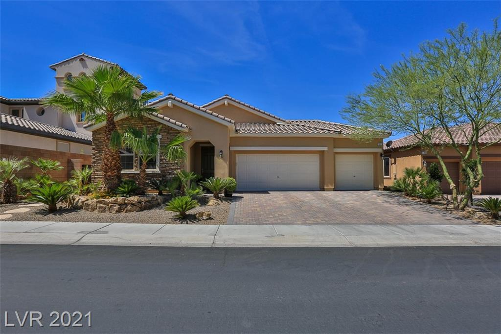 GOLF COURSE LIVING AT ITS FINEST! BEAUTIFULLY UPGRADED SINGLE STORY HOME WITH 3 CAR GARAGE AND SPARKLING POOL CENTRALLY LOCATED IN THE MASTER PLANNED GOLF COMMUNITY OF TUSCANY. OPEN FLOOR PLAN WITH 2 BEDROOMS AND DEN. BEDROOM ONE HAS MURPHY BED INSTALLED FOR ADDITIONAL SPACE IF NEEDED, SECONDARY BATH HAS KHOLER WALK IN BATH WITH JETS. SEPARATE DEN HAS LIBRARY WALL BUILT-IN AND A GREAT OFFICE SPACE OVERSIZED MASTER BEDROOM WITH WALK IN SHOWER AND WALK IN CLOSETS. FAMILY ROOM WITH FANS AND PLANTATION SHUTTERS THROUGHOUT. A CHEF'S DREAM GOURMET KITCHEN WITH STAINLESS COOKTOP AND DOUBLE OVENS, LEVEL 3 GRANITE AND RAISED PANEL MAPLE CABINETS, OVERSIZED KITCHEN ISLAND PERFECT FOR ENTERTAINING FAMILY AND FRIENDS. WOW TAKE A LOOK AT THIS BACKYARD! A UNBELIEVABLE VIEW OF SOME OF THE BEST FAIRWAYS IN HENDERSON!SPARKLING POOL WITH VOLLEYBALL NETS, WATERFALL SITING AREA, GAZEBO WITH BUILT IN BBQ AND FRIDGE, MOTORIZED DROP SHADES, THE PERFECT PALCE TO RELAX WITH FAMILY AND FRIENDS!MOTIVATED SELLER!