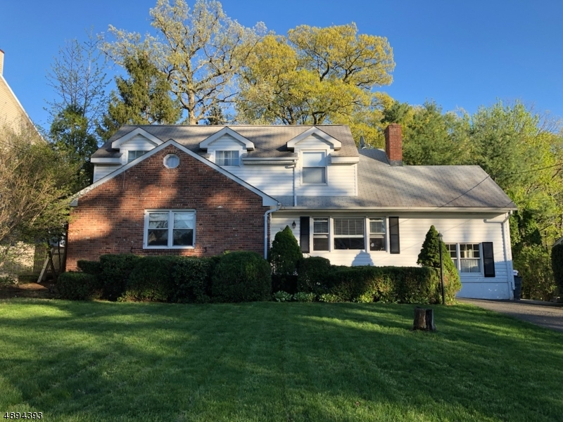 Spacious 5 BR 2BA Cust. Col in sought after Fanwood neighborhood. Close to EVERYTHING- Schools, NYC Train (0.5 mile) & both vibrant Scotch Plains/Fanwood Downtowns. 1st Fl boasts gleaming HWFs, LR w/ fireplace, Fam Room flooded w/ natural light, updated Chef's Kitchen w/ 6 burner Viking prof. range, granite counters & abundant storage. An accessible bedroom w/ adjacent full bath completes the layout of the 1st level. 2nd level w/ HWFs has 4 generous sized bedrooms, ample closets & a full bath. Beautifully finished bsmt w/ HUGE carpeted rec room, storage room, & utility room w/ workshop. Situated on over half an acre of sprawling level land, this home offers an deep, parklike backyard w/ storage shed, & large composite deck w/ ramp, perfect for entertaining or relaxing. A perfect place to call home!