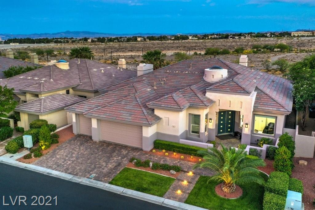 EXCEPTIONAL DESIGNER HOME IN SUMMERLIN'S AVENTURA GUARD GATED COMMUNITY. FROM THE 24X24 CALCUTTA TILE THAT WELCOMES YOU TO THE MODERN STOREFRONT GLASS OFFICE & YOUR DREAM KITCHEN FOR THE INSPIRED HOME CHEF: THERMADOR CONVECTION OVEN MICROWAVE SUBZERO REFRIGERATOR COVE DISHWASHER & WOLF 6 BURNER COOKTOP APPLIANCES. TIMELESS BLACK & WHITE CABINETRY W/ SOFT CLOSE & BLACK MODERN HARDWARE. HUNTER DOUGLAS WINDOW COVERINGS T/O GORGEOUS FLOOR TO CEILING TILE SURROUNDING FIREPLACE WET BAR & WINE FRIDGE FOR ENTERTAINING. ENJOY PANORAMIC VIEWS OF THE MOUNTAIN & THE CITY W/ BREATHTAKING SUNRISES & SUNSETS. UNWIND IN THE SERENE BACKYARD W/ NO NEIGHBORS DIRECTLY BEHIND YOU. OUTDOOR ENTERTAIN W/ HEATED SALTWATER POOL & WATERFALL W/AUTOMATED LIGHTING OUTDOOR SPEAKERS BUILTIN BBQ & EXPANSIVE COVERED PATIO. RETREAT TO YOUR MASTER'S SUITE W/ FP JETTED SOAKING TUB LARGE WALK-IN SHOWER.  HOME AUTOMATION FOR THE SOPHISTICATED BUYER W/AUDIO SECURITY HEATING & COOLING. NEWLY REMODELED TOP TO BOTTOM.