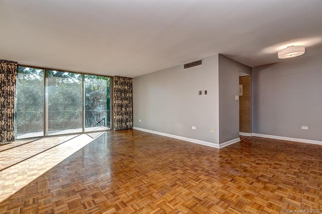 Updated, move-in ready condo located in a sought-after mid-century modern building in Myers Park. Located on the 3rd floor, this beautiful corner unit overlooks tree-lined streets and offers a peek-a-boo view of the skyline. Updated kitchen has white cabinets, quartz counters, stainless steel appliances, and a marble tile backsplash. Owner's suite has wall-to-wall closets and an upgraded en-suite bath with a large vanity and glass shower with white subway tiles. The 3rd bedroom also makes for a wonderful office space. 3-panel sliding glass door opens up to the covered balcony, perfect for indoor-outdoor living. Combination washer-dryer in unit for easy laundry options. Enjoy the secure building, convenient elevator, picturesque community pool, and great parking, all in the heart of Myers Park. Close to restaurants, shops, and Freedom Park. HOA dues cover: electricity, gas, water/sewer, basic cable, and building/grounds maintenance.