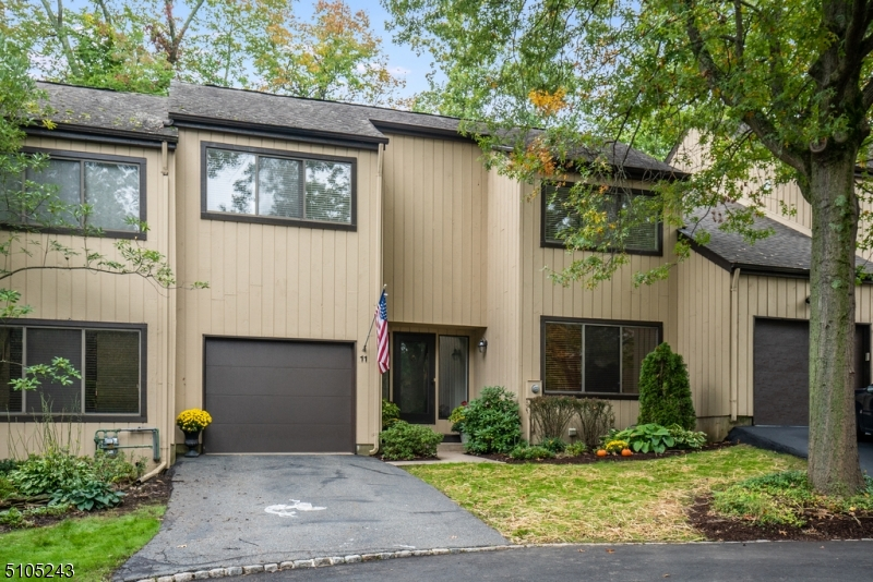 Wow! 2 BR Townhouse with taxes under $5,000! AND Pool & tennis! Freshly painted. Easy access to theatre, restaurants, shopping, major highways and public transportation. Finished bsmt. with 3rd full bath.1st floor wood floors. LR/DR with cathedral ceiling, sliders to 30'deck overlooking private backyard.1 car garage.