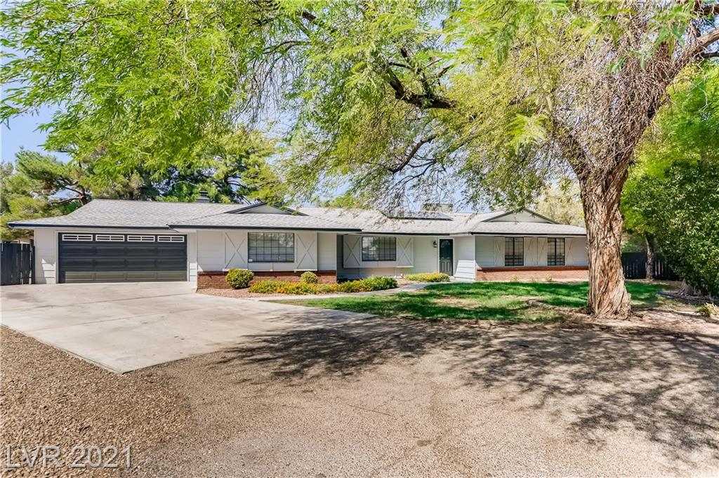 """A true oasis. Gorgeous, Fully Renovated, Single Story 4 Bed home siting on nearly a half acre lot, Quaintly tucked away in a cul-de-sac. Beautifully landscaped with mature trees and manicured vegetation in both the front and rear yards. Fenced RV/Boat area. Shading trees to escape the sun after basking in the large sparkling pool (updated with New tiles). This Beauty's New Interior, WOW! Walking into Your New Home You will invited by a the """"NEW""""! New paint wall to wall. New water proof Laminate Flooring leading You through the home. From the entry to the Dining Room on into the Kitchen and Family room with displays a beautiful brick fireplace. Kitchen is open to the Family room with New Counters, New Quartz Counters, New Cabinets and New Stainless Steel Appliances and Sink. New Recessed lighting and Ceiling Fans throughout. New Carpet in All Beds and Living Room. New Bathroom Cabinets, Counters and Fixtures. There's more but I think You get it. Your New Home has Just about Everything!"""