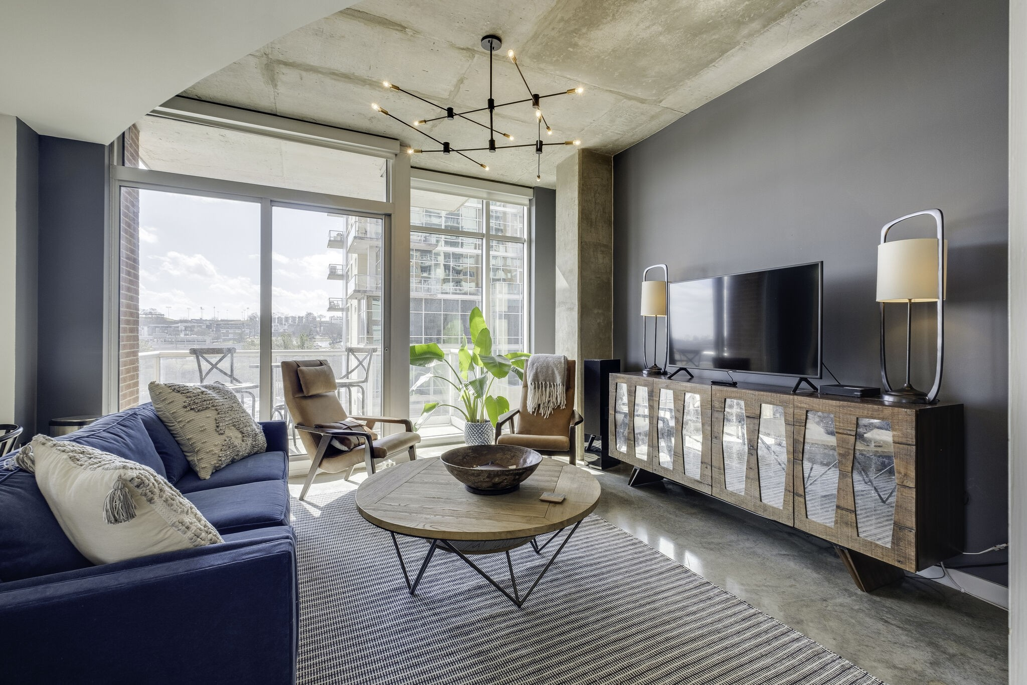 Stunning Corner Unit in the heart of the Gulch.  Open Kitchen & Living Room, SS Appliances, Granite Countertops, Fully Enclosed Bedroom, Tub/Shower Combo, Oversized Balcony, Full Concierge Service, 2 Pools, 2 Fitness Centers, Walking distance to shops & restaurants.