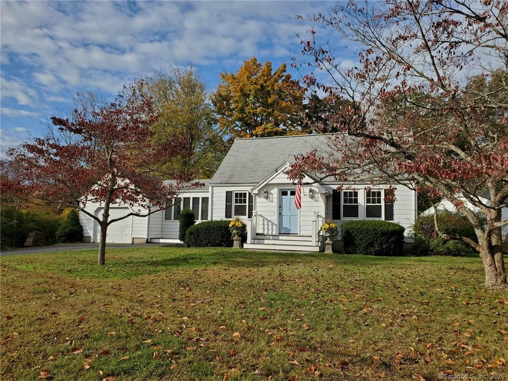 Completely renovated cape in friendly University area neighborhood will not disappoint. This charming home has been updated with modern conveniences and open plan layout which utilizes on-trend fixtures, finishes and neutral tones. Walk up the new bluestone front walk/steps, through a crisp CT blue door and arrive in the wainscoted foyer with slate floor and coat closet. The heart of the home is a white Shaker style island  kitchen with stainless appliances, quartz counters and subway tile backsplash. The kitchen is open to the dining room and family room with vaulted, beamed ceiling, walls of glass and doors to the front and back yards. The first floor also features a formal living room, bedroom and tasteful new bath with white vanity, built-ins and large shower with frameless glass sliding doors. The second floor features two bedrooms and full bath with white Shaker style cabinetry, built-ins and tub/shower combination. A partially finished lower level features a rec room with LVT plank flooring and a home office option with numerous storage closets. Central AC, city water. Enjoy the outdoors while sitting on the front porch chatting with neighbors or revel in some private time in the flat backyard with beautifully landscaped planting beds. Convenient location in picturesque coastal CT town; near universities, shopping, restaurants, golf, highways,  train, lake, beaches, marina & parks.