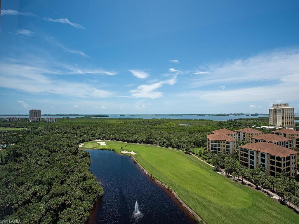 Enjoy an open great room style floor plan and stunning 16th floor water & golf course views set against Southwest Florida's most beautiful natural scenery. 3 bedrooms, and THREE FULL BATHS, 1 car garage space, and 2nd level storage closet. Be inspired by gorgeous views from a wide and spacious tiled terrace. FULLY FURNISHED AND AUTOMATIC SHUTTERS. Stainless steel appliances, breakfast bar, and pantry. Master suite with terrace access and dual walk in closets. Master bath includes a spa tub, dual sink vanities, and separate shower. Navona offers a resort style heated pool and spa, cabana lounge, sun deck, social room, movie theater, two guest suites, & fitness center. Enjoy The Colony's unique resort lifestyle with abundant amenities including your private membership to The Bay Club, or take the shuttle to the private beach park. 2 canoe/kayak parks, sailing club and one of our area's biggest tennis programs. Convenient to shopping, entertainment, dining and the airport.