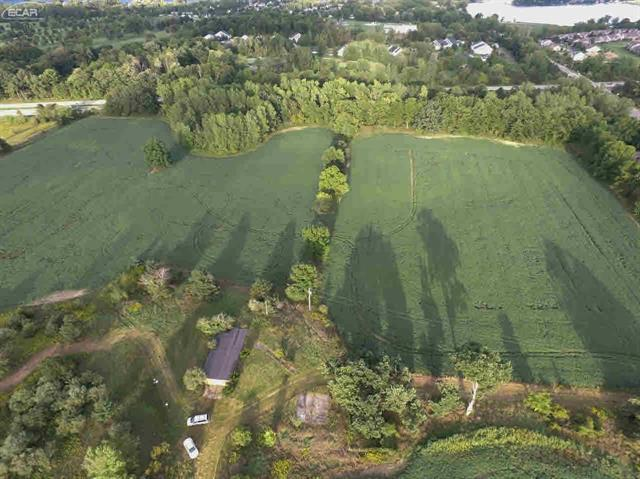 71 Acres of Beautiful Rolling Land For Prime Development/Building Site In Desirable Growing Fenton Township.  Lake Fenton School District (Located Between High School, Elementary and Middle Schools). 920 Feet Of Paved Road Frontage. Over 2,200 Feet Of US-23 Exposure. Zoned Residential R-3. Features Approximately 22 Acres Of Stunning Mixed Woods Casting A Park-Like Setting. This Rare Find Large Parcel Is A Fabulous Opportunity For Condo Development, Senior, Educational or Community Development.   Well, Electric And Gas Already On Property.  Crops Reserved.