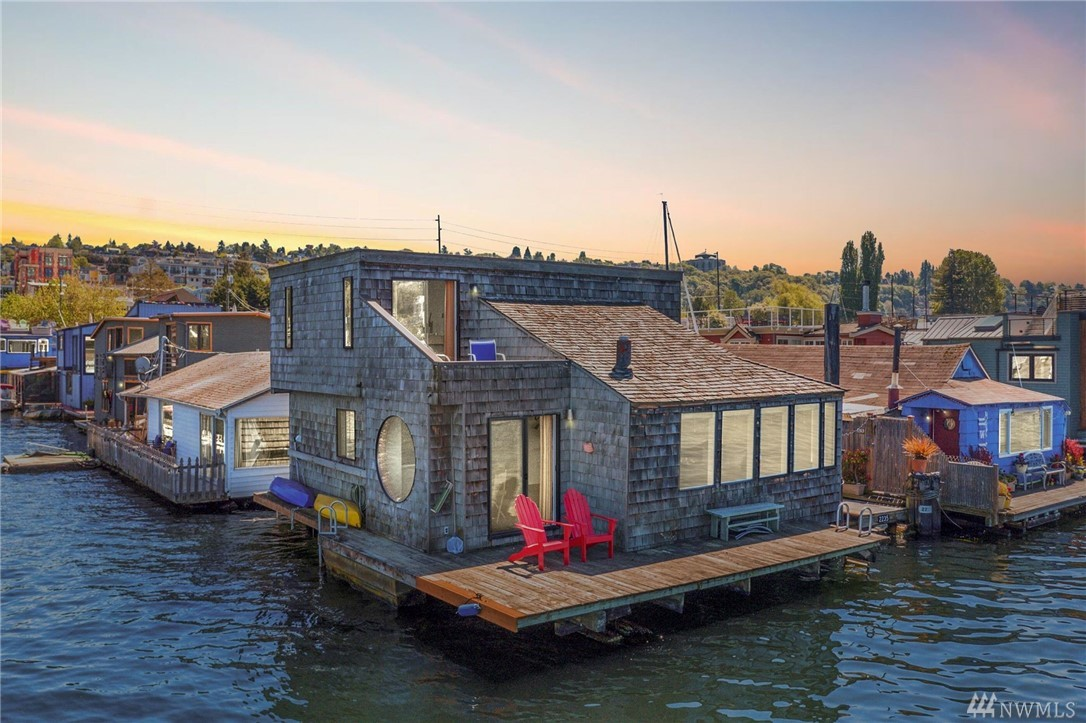 Available for the first time in decades, this jewel of a floating home is a rare find. Sitting at the end of the dock, this home offers stunning panoramic views of Lake Union, from the Seattle skyline to Gasworks Park. This 2-story home features a clean, well-planned open design, w/ every window & angle strategically placed to capture the remarkable views.Thoughtful details include a working porthole & iconic round windows, vaulted ceiling, & bamboo flooring. Coop moorage & room for boat.