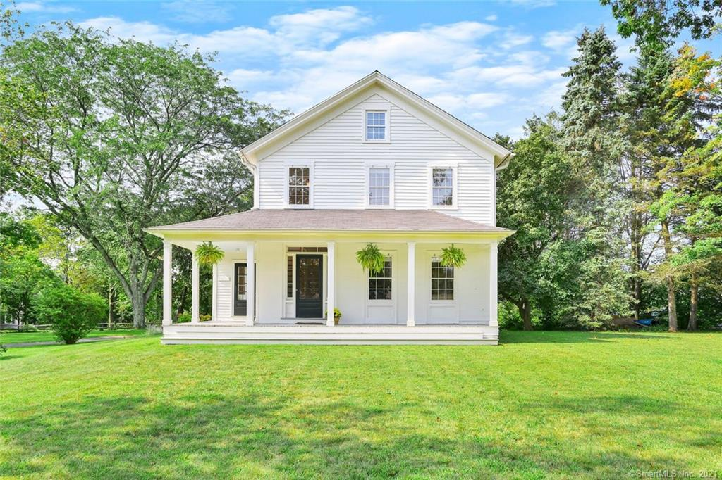 """Quintessential New England farmhouse with impeccable renovations and wrap around porch in an elegant setting behind a picket fence. Located in Lower Easton which was described by the New York Times as the """"black pearl of Fairfield County."""" Architectural features of this sun-filled home include back-to-back fireplaces, large cased openings, 8' 9"""" ceilings, custom millwork and built-ins. High-end kitchen includes Wolf Gas Range and Sub-Zero. Hardwood flooring throughout, Marvin Divided Light Windows, all newer electrical, HVAC, plumbing, and lighting. Baths have elegant finishes including Carrera Marble, Waterworks and Barber Wilson fixtures. Private, level backyard is just under 1 acre with views of mature trees, stone patio and a quiet neighborhood on the other side. Rare trifecta of Natural Gas, City Water and Central Air. Award winning schools. Easton is home to over twenty working farms, yet is minutes to Fairfield & Westport. Easy commute to New York City."""