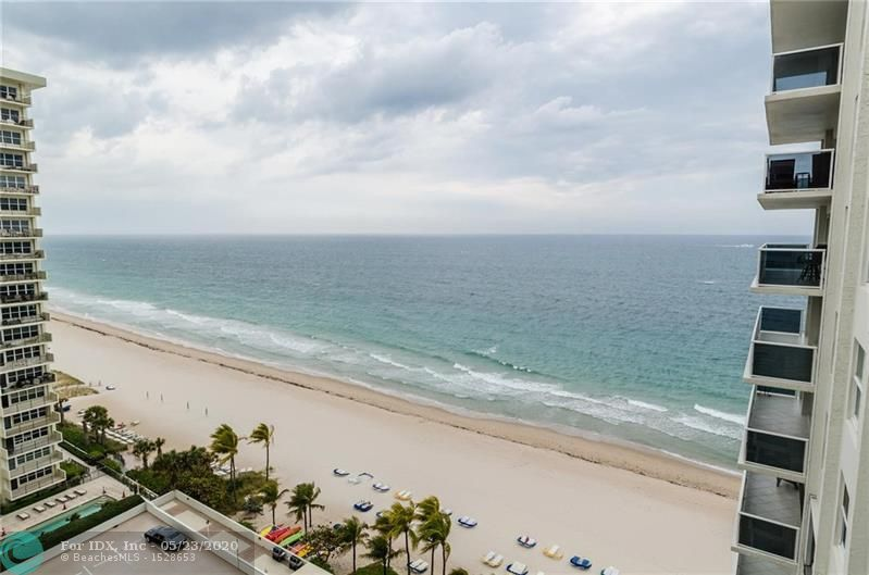 This prime NE facing  ocean view condo is located in a premier oceanfront building on Galt Ocean Drive. The kitchen has been opened and remodeled with wood cabinets, granite counter tops and stainless steel appliances. The home has upgraded baths, impact windows and doors, a washer and dryer in the unit, an open glass balcony, a storage locker on the same floor and deeded garage parking.  A separate area off the Master Bedroom can be used as a 3rd sleeping area.  The building has nearly completed strikingly beautiful renovations to the lobby, the community room and the parking garage.  Relax at the beach, swim in the pool, exercise at the gym or stroll along the Galt to the supermarket, or one of the many shops, restaurants, or bakeries. You will love your new oceanfront home