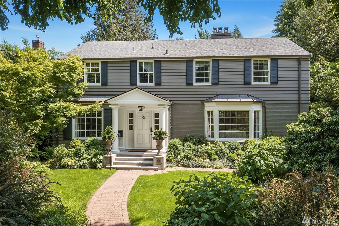 Only occasionally does one of Washington Park's coveted colonials become available for purchase. This one is special! Sited on a quiet, tree-lined street, this classic home offers the perfect blend of quintessential style with all the right spaces & amenities for today's lifestyle. Gracious living & entertaining rooms, chefs kitchen, spacious & warm main floor family room. French doors to entertaining terrace & casual English gardens. Just a short walk to the shops & restaurants of Madison Park.