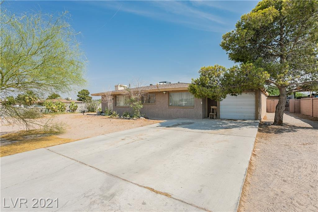 Once in a lifetime opportunity to purchase a horse property on close to 3 acres in Las Vegas! No HOA! Tons of potential! 126,000 Sq. Ft. lot, plenty of room for cars, boats, or RVs. More than enough land to install your own pool or even build another property! This is an investors dream! Workshop area and stables for your livestock! 1554 Sq. Ft. home, open floor plan with wood burning fireplace. 3Bd, 2Ba, and 2 outdoor bathroom stalls. Long multiple car drive way! 15 minutes away from the Fremont Experience!