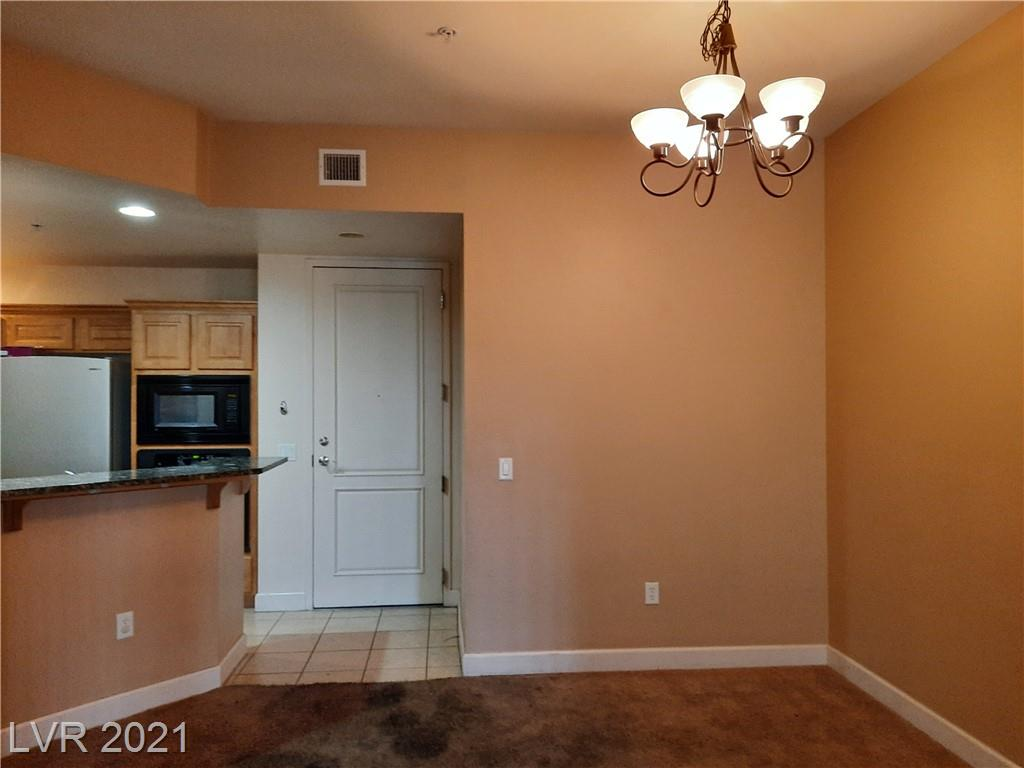 Nice condo in the upscale Park Avenue mid rise complex. Guard gated, with two pool areas. Clubhouse, with exercise room. Tennis courts. Great location just off Las Vegas Blvd, convenient to shopping, Allegient Stadium . T-Mobile arena and entertainment. This unit offers granite counters in kitchen, built in oven, cooktop, microwave, refrigerator.  Tile flooring in Baths and Kitchen, ready for new  carpeting. Two bedrooms, two baths. Third floor of 5 story building.