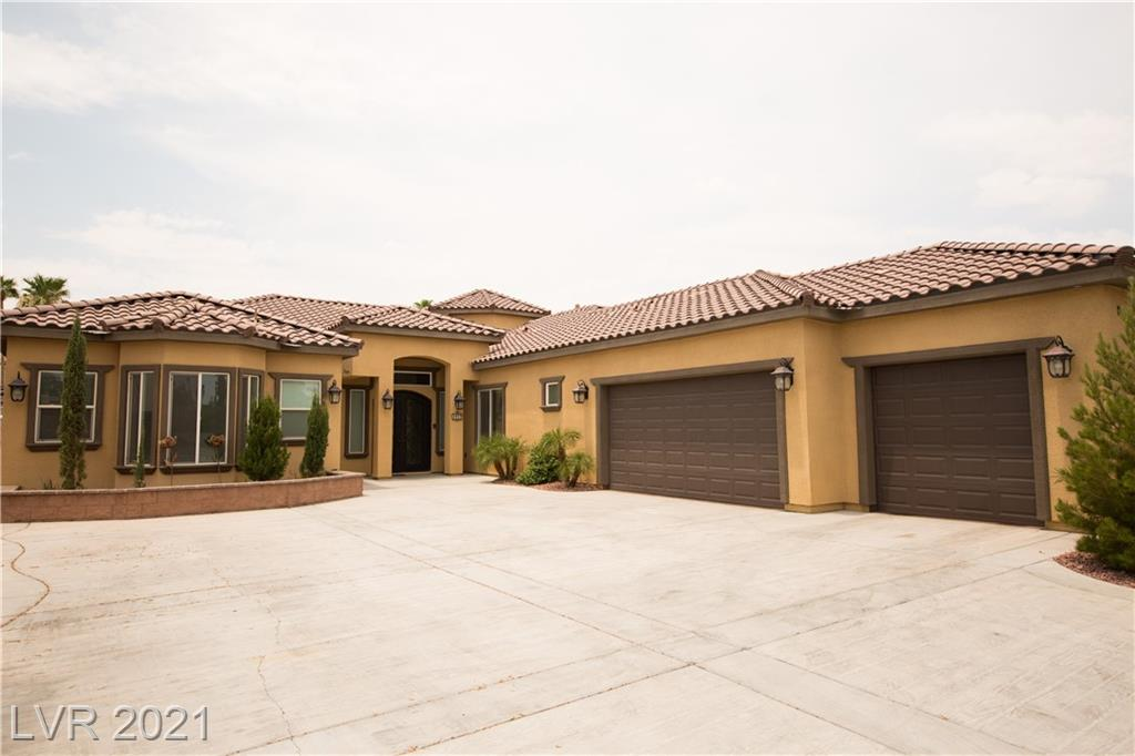 Gorgeous, custom built, 2017, single story, four bedroom home in a gated cul de sac! Each bedroom has their own bathroom attached! Primary bedroom is located on the left wing of the house with its own door to access the backyard covered patio. All other bedrooms are located on the right wing separated from primary. In the right wing, two bedrooms have access to the backyard. One room with a door to the side yard & a second room with a door to its own private patio towards to the front of the property. A stunning grand entrance of the home brings you into the formal living area and to the left is the spacious kitchen with island bar stool seating, vaulted ceilings, a walk in pantry, built in oven, built in microwave, and all stainless steel appliances. The backyard features a relaxing fully covered patio, turfed seating area, covered fire pit, above ground jacuzzi, built in BBQ island, and desert landscaping. The driveway fits multiple vehicles with a three car garage facing the south.