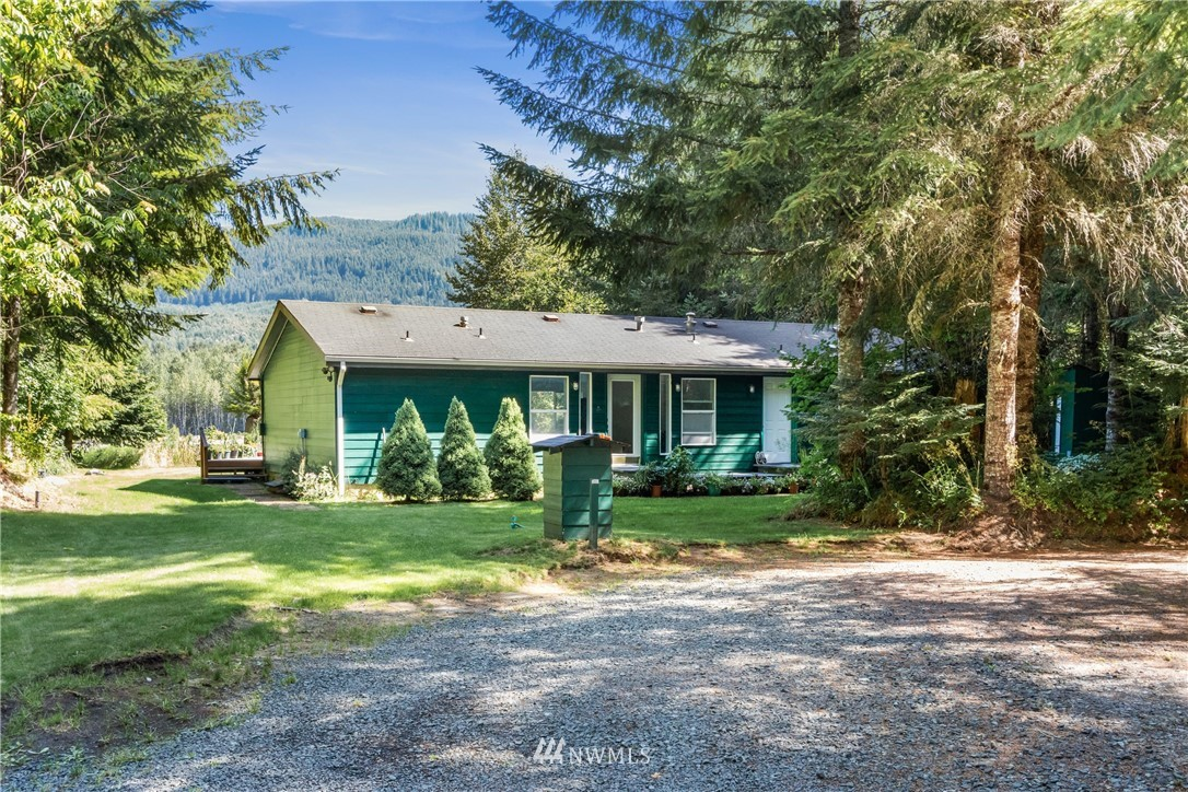 RARE RIVERFRONT PROPERTY~5 Acre on Nisqually River 2 homes located in Gated Community with free roam wildlife area mandated, elk dominated.  Main home is an open concept with 2484 SF, 3 Beds, 2 Baths. Second home 1100 SQ FT relatively new 2 Bed + 1-3/4 Bath W/1100 SQ FT attached heated garage, shop, laundry room. There are 2 RV pads w/h20, sewer, power. Separate building for pump room. Separate building for generator, tool storage . Propane tank owned 500 gallons, many outlets for exterior ground lighting. Long driveway to home on river thru heavily forested area with 18 kinds of evergreens. Absolute must see in person. Hot tub stays, stove to be installed at closing.