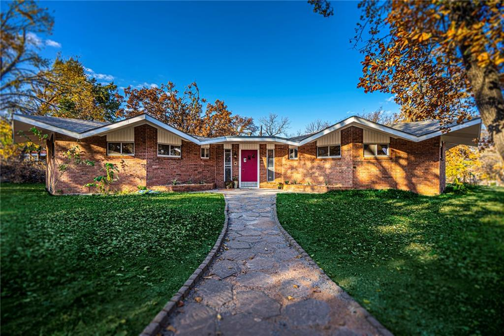 Come by and check out this This Mid-Century Modern home..  House  sits on 1.74 Acres (mol) and is located Just minutes to Down Town Edmond, Shopping  Dining and only 2 1/2 miles to  I-35 for an easy commute to anywhere in the Metro. Tons  of natural light and beautiful mature trees .   Many updates have been made, Brand new roof 11/2020, Laminated flooring thru out except kitchen, Updated appliances, counter tops sink and faucet and backsplash and tile in kitchen , updated to aerobic septic system , Hot water tank 2018, new HVAC 2018, New well Pump 2018,  fresh paint through out and updated lighting in main areas .  Added  fire pit and Pergola , slate patio steps .  Property has a detached 2 car Garage, Well House and Out Building  and circle drive with   Ample parking