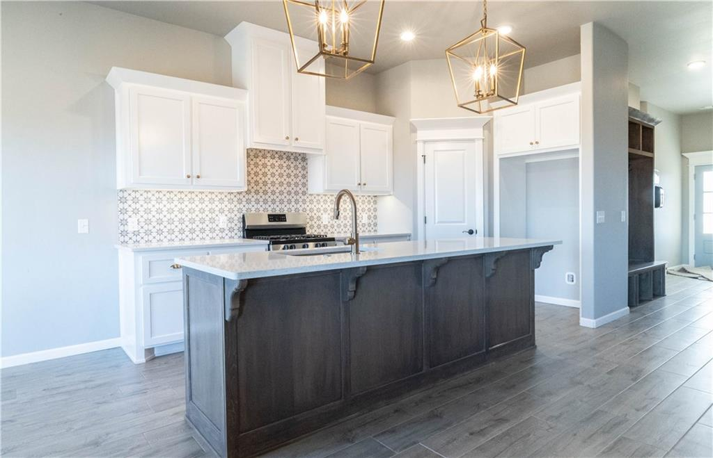 This Teagen floorplan includes 1,715 Sq Ft of total living space, which includes 1,625 Sq Ft of indoor living space and 90 Sq Ft of outdoor living space. There is also a 390 Sq Ft, two car garage with storm shelter installed. Home has a total of 3 bedrooms and 2 full baths. Large family room with a cozy corner gas fireplace, and a large window with lots of natural light. Kitchen has a large island with sink and dishwasher, topped with 3 cm quartz, and custom vent hood and cabinetry. Rooms include spacious closets and ceiling fans. The master suite includes a ceiling fan, and a vaulted master ceiling. The master bath includes a walk-in shower, Jetta whirlpool tub, dual counter top vanities, and spacious master closet. The back patio is covered with a wood-burning fireplace, gas outlet for grill and TV hookups. Other amenities include Smart Home Technology, whole home air filtration system, Rinnai Tankless water heater, R-44 insulation and a TechShield radiant barrier!