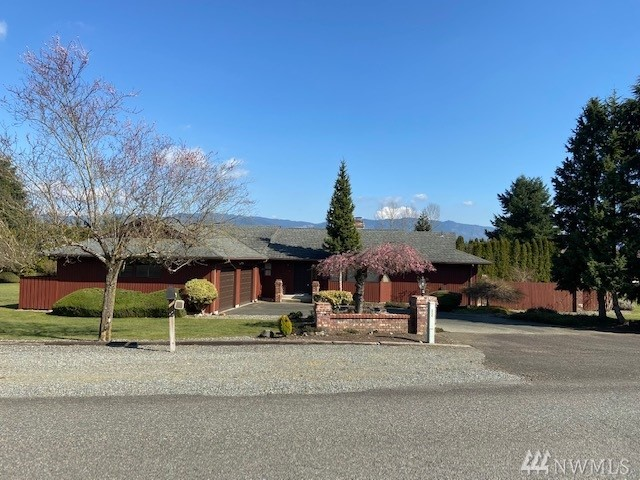 This well cared for rambler sits on a relatively private corner lot just shy of 1 acre, has incredible views of Mt. Rainier, and has a nice small orchard of apple trees. With a covered & fenced deck (opens to the large yard) featuring a hot tub, and a fire pit, this can either be a secluded paradise or ideal for a social gathering. This home will not last long!