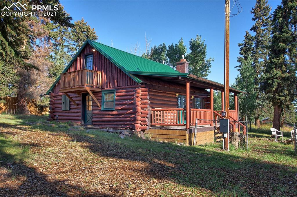 Charming hand-hewn Log Cabin built from local community trees is just what the doctor ordered! Huge covered Front Porch invites you to read, chat, barbecue, or just enjoy the Beautiful Treed Setting. Lush grass, Majestic Pines & Colorful Aspen adorn the lot & streets. Most of the yard is fenced for pets & kids to play safely.Inside, you'll find wide-plank pine floors, log/tongue & groove walls, ceramic tile kitchen, tankless water heater, clawfoot tub, Remodeled Bath, Newer Paint..& Much More..