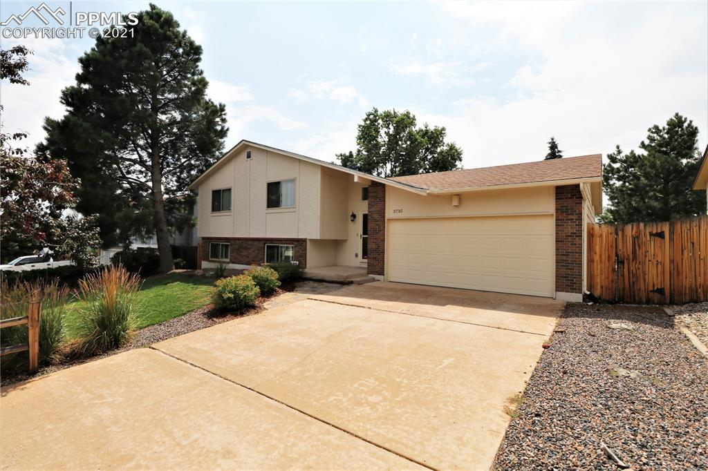 Enjoy the beautiful views of the mountains and Pikes Peak all from your back deck that is a walk out from the master bedroom.  Enjoyment and comfort is the name of this home.  Nice Tri-level with 3 large living areas. As you walk in, go up, down or straight into a great rec room with a fireplace and built ins and Anderson windows.  One wall is full of windows to give you great natural light. Head up stairs to the living room, dining room and kitchen.  The huge master and a full bath are also on this level.  If you head down the stairs you arrive at the family room. You can walk out to the backyard from this level.  This level is finished off with two bedrooms, a full bath and the laundry room.  You will also get a new furnace, Hot water heater, humidifier, This is a 2,547 sq ft home that has lots of open space and yet is very welcoming.