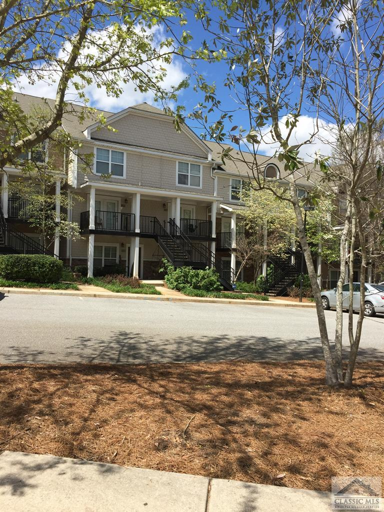 RENTED THROUGH JULY, 2022!!   Current rent is $950 thru July, 2021 and renewal lease is $1000 from August - July, 2022. Managed by on site management.   2-story style condo with 2.5 baths.  Open floor plan with laminate floors on main level.    Upstairs Bedrooms with vaulted ceilings.  All appliances included.   Premier gated student community with amenities: (clubhouse, tennis/bball/volleyball courts; pool)..  Great for investor or for buyer who doesn't need occupancy until August, 2022.   Note:  Photos are without tenant furniture.
