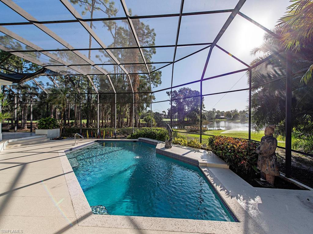 H.16355 - Well-maintained pool home on one of the few one-acre lots with long lake and golf course views. Remodel and put your own stamp on the existing contemporary design home or tear down and build the home of your dreams here. Spacious rooms inside are enhanced by big windows and volume ceilings, some with beautiful tray accents. Quality materials include marble and granite counter tops, tile and wood floors, and crown molding. Views of the lake and golf course can be enjoyed from the family room, morning room and the kitchen, which boasts custom, imported Poggenpohl cabinetry. The oversized pantry and laundry/catering kitchen give plenty of storage. A guest cabana complete with full bath, living and sleeping area, and kitchen will accommodate your visitors. Live the Florida lifestyle out on the immense lanai that surrounds a pool and water feature. This home also features a three-car attached garage, newer roof and top line appliances. The vacant lot next door is also available for purchase separately. MLS #220059858.