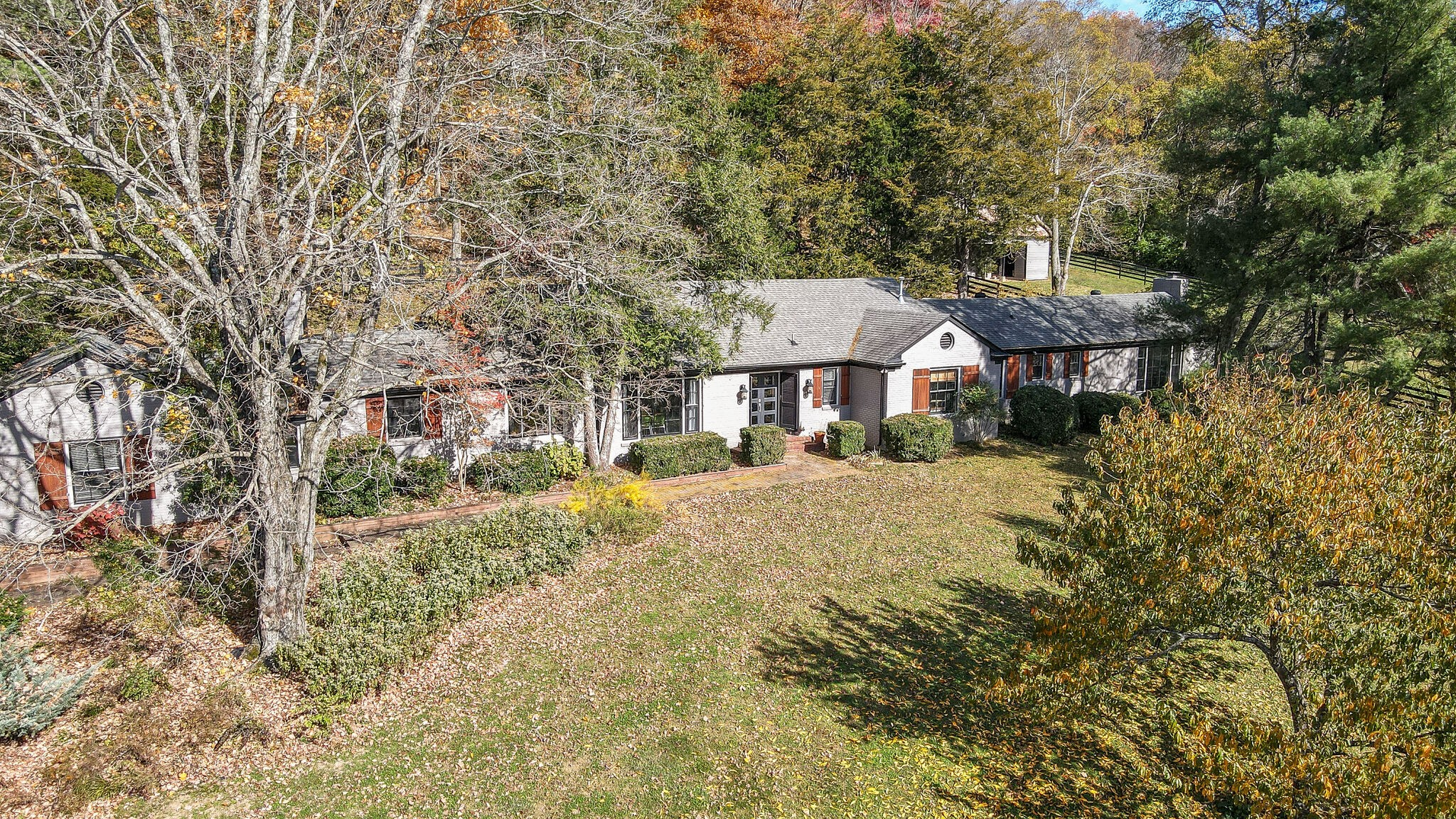 Truly amazing retreat nestled on 5 acres right in the city! One level living that has been mindfully renovated while keeping the charm and adding every modern convenience. Entertaining areas inside and out. Rare opportunity in this location to bring your horses ~ 2 stall barn and chicken coop. First showing Monday, Nov 16th