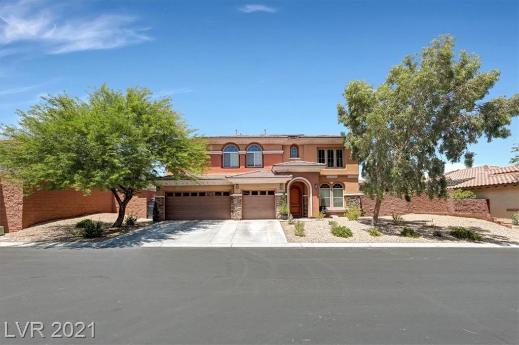 Beautiful gated community pool home in sought after Mountains Edge! A grand entrance welcomes you to this spacious home. On the first floor you will find a formal living and dining area, large kitchen with granite counter tops and breakfast nook, family room, laundry room, bedroom and 3/4 bath. Upstairs you will be amazed by 3 more bedrooms and not one, but two open loft areas. Main loft has a wet bar ready for entertaining. Primary bedroom and bath are designed for the tranquil retreat you deserve. There are 2 oversized secondary bedrooms and an additional bathroom suited for any family's needs. Outside an oasis like backyard awaits your relaxation time. A wet deck pool/spa combo with gas AND solar heating, covered patio and large side yards for whatever you can dream up. Solar electric panels will keep those power bills at bay and a 3 car garage for all your toys. This home has it all and is a must see! Call Jon for a showing appointment now!
