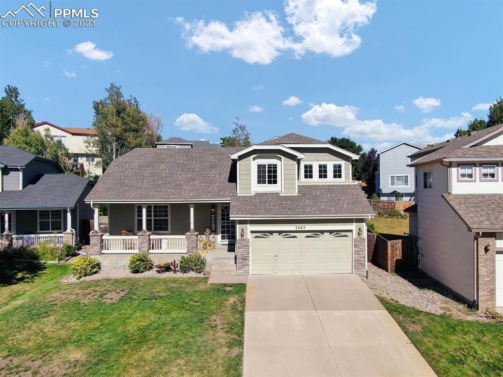 You will fall in love with this beautifully updated 4 bedroom, 4 bath home in the desirable Springs Ranch neighborhood! Enjoy watching the Colorado sunsets from your large covered front porch! Gorgeous hardwood floors, vaulted ceilings and windows of natural light greet you upon entry and lead to a spacious open living room! The large kitchen boasts of a kitchen island, stainless steel appliances, gas range and ample sized pantry! Dining room offers plenty of space for hosting and entertaining! The lower level walk-out has beautiful laminate floors, gas fireplace, shiplap accent TV wall, updated 1/2 bath and laundry room with shelving! The lower level walks out to a fully fenced backyard with an expansive deck, manicured landscaping and is the perfect retreat for relaxing, entertaining and enjoying the incredible Colorado outdoors! Upstairs you will find a large master suite with a custom barn door, walk-in closet and a recently updated spa-like master bathroom with dual sink vanities & a stunning walk-in shower! Two additional bedrooms with views of the front range and a full bathroom round out the upstairs! Enjoy the fully-finished basement that boasts of a secondary family room, updated full bathroom with walk-in spa shower, and a guest bedroom with barn door and shiplap accent wall! Large crawlspace leaves tons of room for all your storage needs! Air conditioning to keep you cool in the summer months! Conveniently located near schools, parks, shopping, entertainment and military bases! Move in ready & one you won't want to miss!
