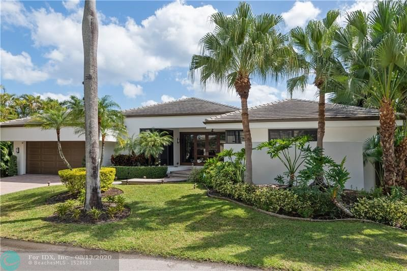 Newly upgraded one story Las Olas Isle home with 100' of water and an east facing backyard. A stunning double door glass entrance welcomes you into your open living area with  walls of glass to enjoy the pool and water views from most rooms. This 4 bedroom + den, 5 bath home is complete with a new gourmet kitchen, updated bathrooms and impact windows and doors.  The luxurious master bedroom and bath has two generous sized closets and direct access to the pool area which has a large covered lanai for outside entertainment space. Walking distance to the Shops and Restaurants on Las Olas Blvd and close proximity to the Beach.   Private dock with no fixed bridges and ocean access.